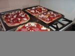 Finally nearly time to eat- just got to bake off the pizzas