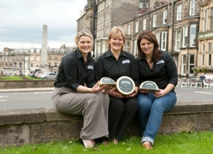 Katy, Judy and Caroline holding the new Harrogate Blue in the Town centre